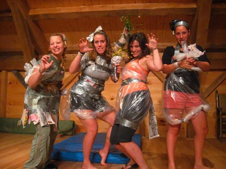 Girls participating in trash bag fashion show