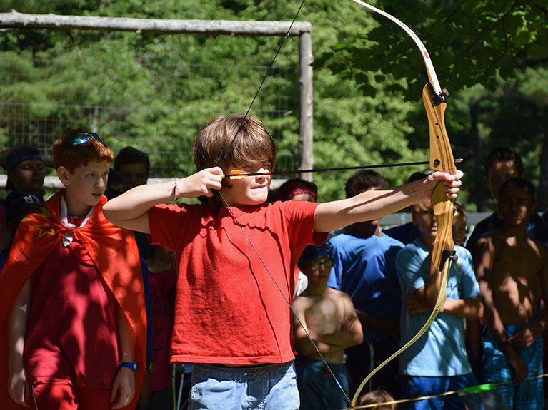 Boy shooting arrow