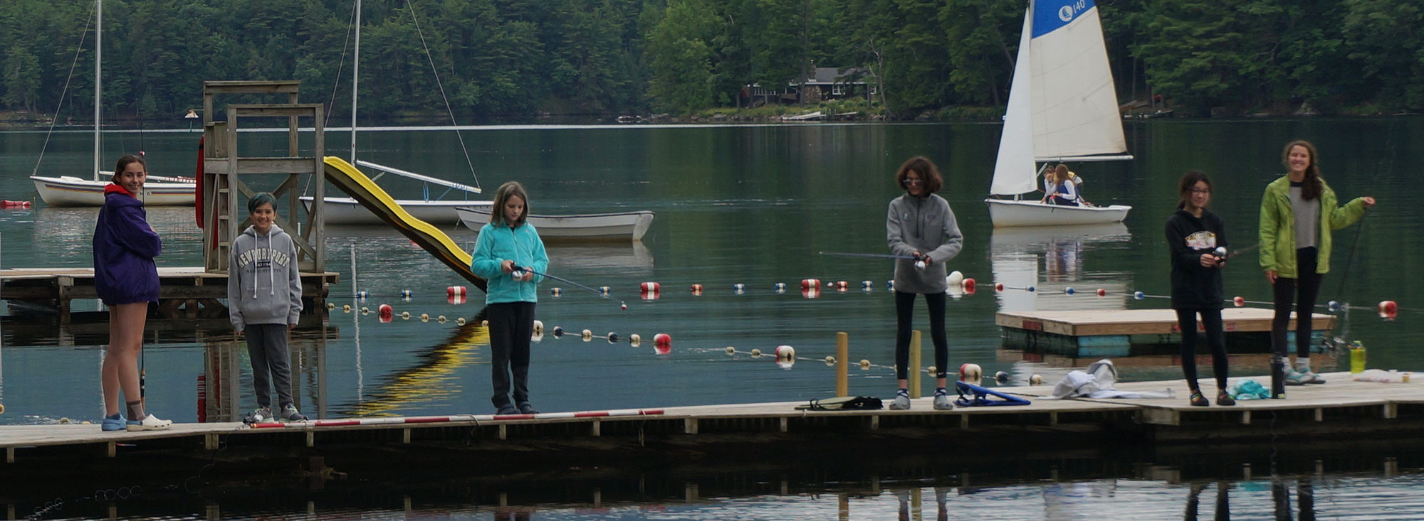 campers on dock fishing