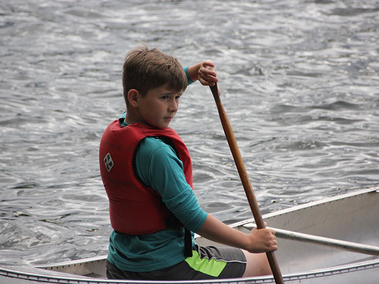 Boy in Canoe on lake